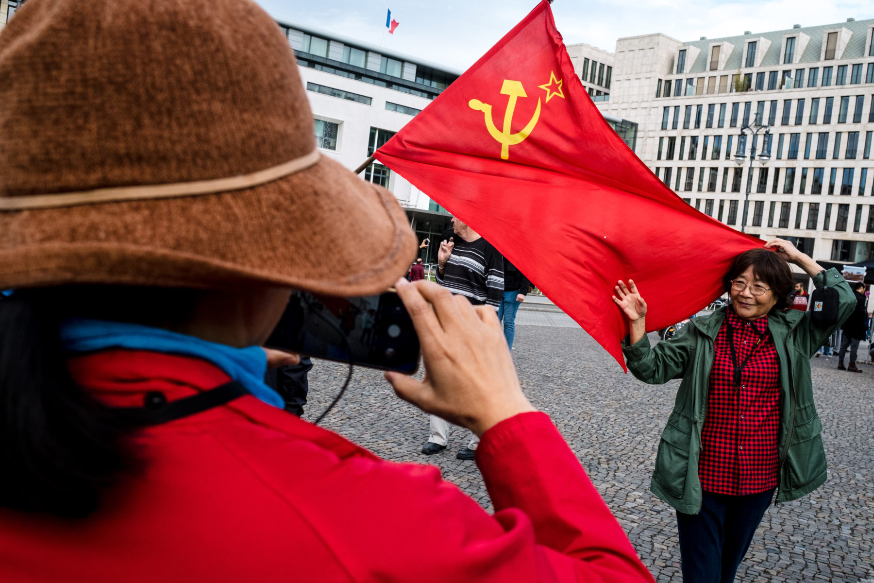 tourists with communist flag